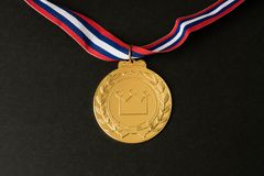 Golden medal Sport competition with red  blue and white ribbon o. N  black background Royalty Free Stock Photos