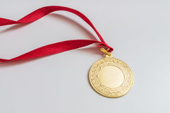 Golden medal on white background Stock Photography