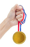 Golden Medal In Woman Hand. Stock Photo
