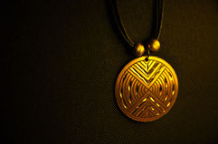 Golden medallion Stock Images
