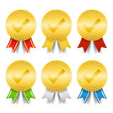 Golden medals with check mark Stock Photography
