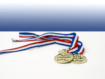 Golden medals for the first three winners Stock Photography