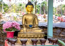 A golden meditating buddha statue in Bhutan style royalty free stock images