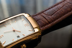 Golden Men`s Wristwatch on a Black Background. Stock Photos