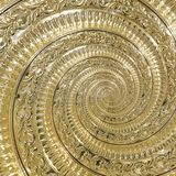 Golden metal abstract spiral background pattern fractal. Decorative ornament element. Golden metallic decorative ornament element. Gold metallic background Stock Image
