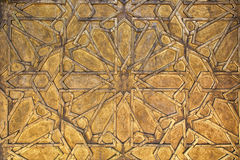 Golden metal background with intricate pattern. Stock Image