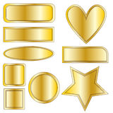 Golden metal buttons, heart and star Royalty Free Stock Photo