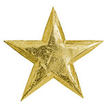 Golden metal christmas star Stock Photos