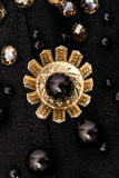 Golden metal flower with black bead in the center Royalty Free Stock Photography