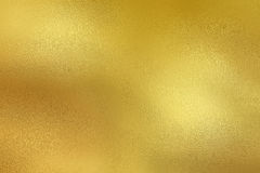 Golden metal foil decorative texture background. Golden metal foil decorative texture paper background Stock Photos
