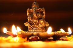 Golden Metal Lord Ganesha Idol With Five Dia , burning lighten up all dia lamp royalty free stock images