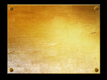 Golden metal plate background Royalty Free Stock Images