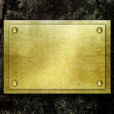 Golden metal plate on concrete wall Royalty Free Stock Image