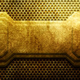Golden metal plate on grid. Industrial Stock Photos