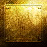 Golden metal plate on grid. Industrial Stock Photo