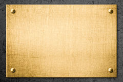 Golden metal plate or signboard on wall Stock Image