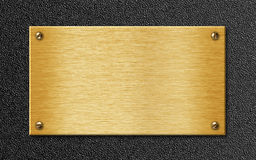 Golden metal plate on textured background stock images