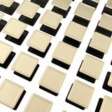 Golden metal plates over black ones as background Royalty Free Stock Image
