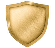 Golden metal shield or crest isolated. On white Stock Photos