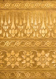 Golden Metal  with Thai Traditional Carving in Contemporary style. Gold Metal Plate with Thai Traditional Carving in Contemporary style, Vertical Pattern Stock Photos