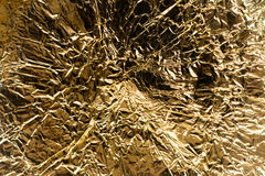 Golden metalized fabric Stock Image