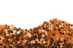Golden metallic confetti Royalty Free Stock Image