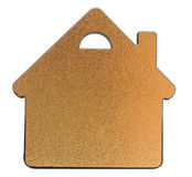 Golden metallic house shaped object Stock Photos