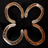Golden metallic lucky horseshoes Stock Images