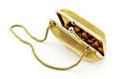 Golden metallic purse with coffee beans Royalty Free Stock Images