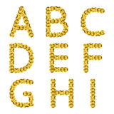 Golden metallic sequins alphabet. Glitter letters. Royalty Free Stock Photo
