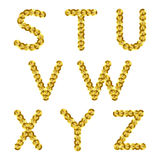 Golden metallic sequins alphabet. Glitter letters. Stock Photography