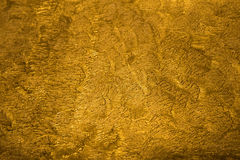 Golden metallic shinny textured background with detail pattern Royalty Free Stock Photo