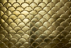 Golden metallic wavy surface. Background of a Golden metallic wavy surface Royalty Free Stock Images