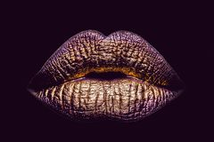 golden metallized female lips