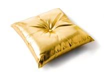 Golden metallized leather cushion. Isolated on white background Stock Photo