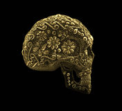 Golden mexican skull on black background Stock Image