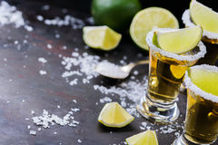 Golden mexican tequila shot with green lime and salt Stock Photo