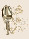 Golden microphone on abstract background Stock Photo