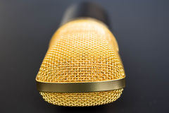 Golden microphone on black Royalty Free Stock Image