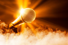Golden microphone on stage. With smoke Royalty Free Stock Photography