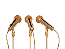 Golden microphones isolated Royalty Free Stock Images