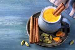Golden milk with turmeric royalty free stock image
