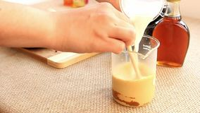 Golden milk drink preparation set. Preparation of Golden milk drink set.nAdd milk over the mixed ingredients step stock video