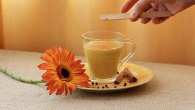 Golden Milk drink preparation set. Golden Milk drink receipt preparation set stock video footage