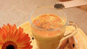 Golden milk drink preparation set stock video