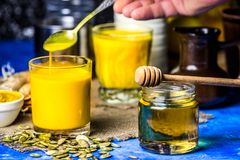 Golden milk in a glass stock photos