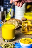 Golden milk in a glass royalty free stock image