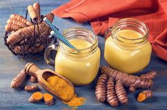 Golden milk with turmeric. Golden milk, beverage with turmeric and spices Stock Photos