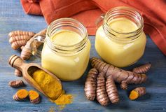 Golden milk with turmeric. Golden milk, beverage with turmeric and spices Royalty Free Stock Images