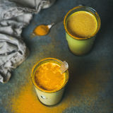 Golden milk with turmeric powder, dieting and weight loss concept Stock Image